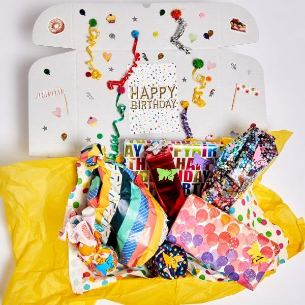 7 gifts with birthday wrapping paper in white box