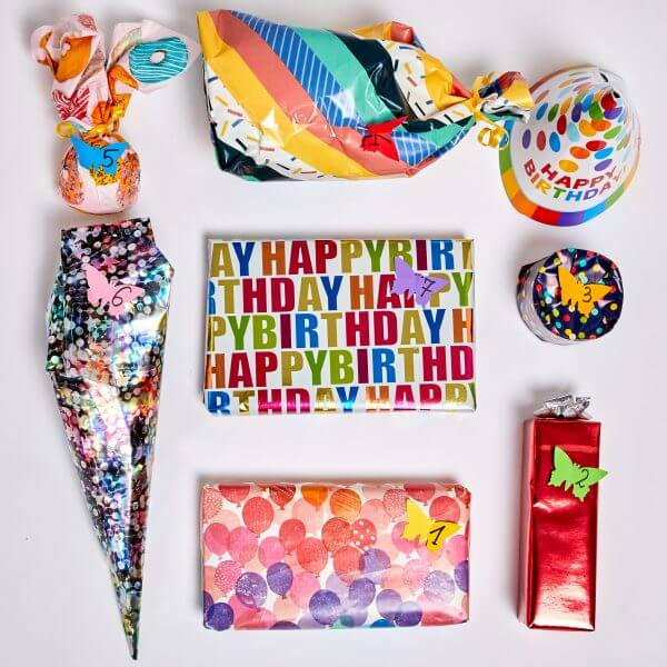 7 gifts in birthday wrapping paper