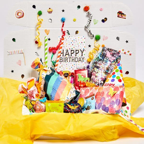 gifts with number counts and white box with birthday theme