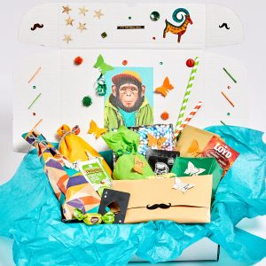 white box with monkey sticker and blue tissue paper
