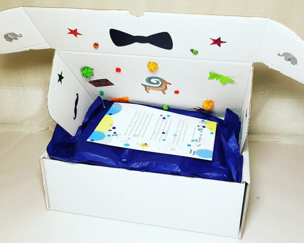 white box with blue tissue paper