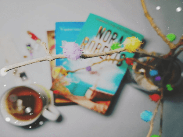 blurred shot of a book and tea cup