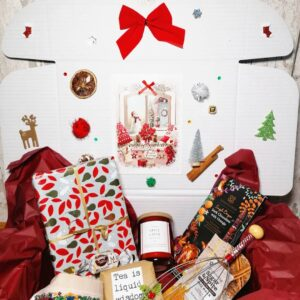 christmas theme gift box with book, tea and head massager